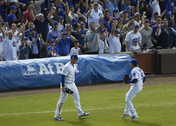 Chicago Cubs' Anthony Rizzo and Javier Baez celebrate after Game 3 of the National League Division Series baseball game against the Washington Nationals Monday, Oct. 9, 2017, in Chicago. The Cubs won 2-1 to take a 2-1 lead in the series. (AP Photo/David Banks)