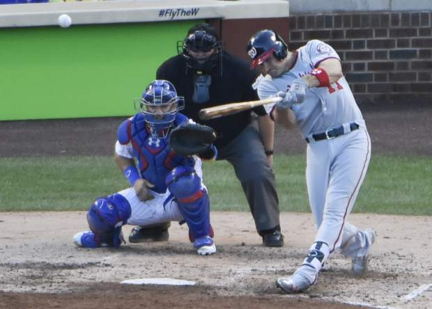 Washington Nationals' Ryan Zimmerman hits an RBI double during the sixth inning of Game 3 of the National League Division Series baseball game against the Chicago Cubs Monday, Oct. 9, 2017, in Chicago. (AP Photo/David Banks)