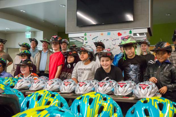 Glenwood Springs Middle School students pose with the brand new bike helmets that were provided by Alpine Bank.