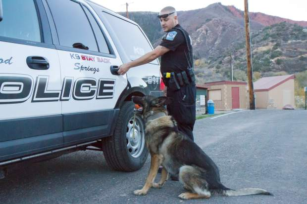 Glenwood Springs Police K9 handler Blake Gobbo and K9 Zeus head back to the patrol car after some obedience work near the police department on Wednesday evening.