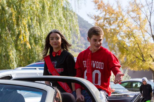 Members of the Glenwood Springs High School homecoming royalty make their way down Pitkin Avenue for the 2017 homecoming parade.