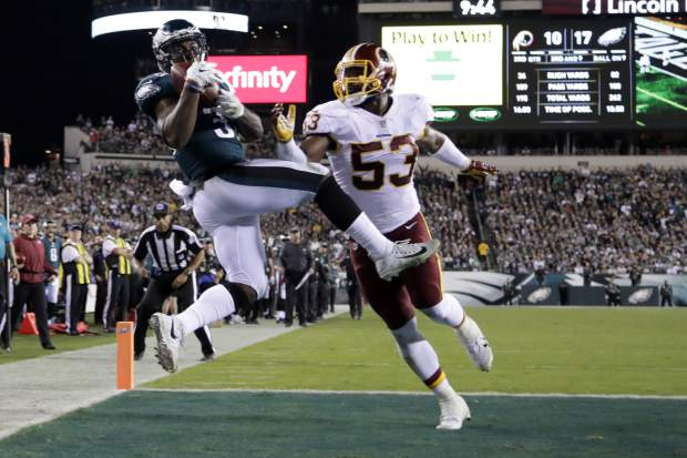 Philadelphia Eagles running back Corey Clement, left, makes a touchdown catch on a pass from quarterback Carson Wentz, not pictured, as Washington Redskins inside linebacker Zach Brown (53) defends during the second half of an NFL football game, Monday, Oct. 23, 2017, in Philadelphia. (AP Photo/Michael Perez)