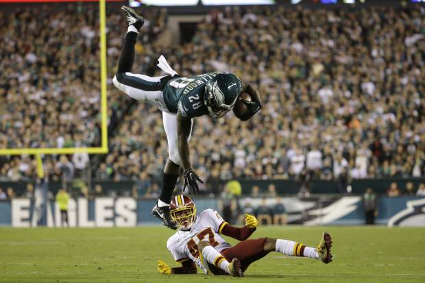 Philadelphia Eagles running back Wendell Smallwood (28) goes airborne while trying to avoid a tackle by Washington Redskins cornerback Quinton Dunbar (47) during the first half of an NFL football game, Monday, Oct. 23, 2017, in Philadelphia. (AP Photo/Michael Perez)