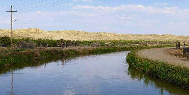 The Government Highline Canal irrigates 12,500 acres on the north side of the Grand Valley from Palisade to Mack. The canal transports water diverted from the Colorado River in De Beque Canyon at the red-roofed roller dam.