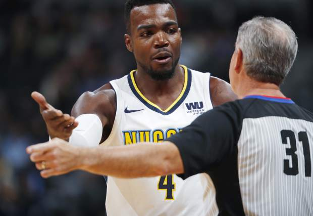 Denver Nuggets forward Paul Millsap, back argues with referee Scott Wall after he called Millsap for a foul on Washington Wizards guard John Wall in the first half of an NBA basketball game, Monday, Oct. 23, 2017, in Denver. (AP Photo/David Zalubowski)