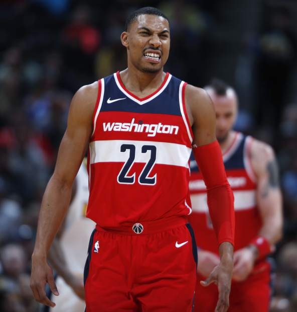 Washington Wizards forward Otto Porter Jr. reacts after a missed shot against the Denver Nuggets in the first half of an NBA basketball game, Monday, Oct. 23, 2017, in Denver. (AP Photo/David Zalubowski)