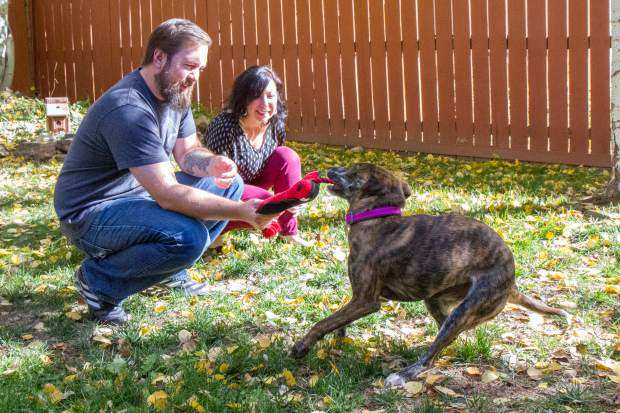 Phoebe plays with her new family Angela Kay and Kyle Mills in Silt.