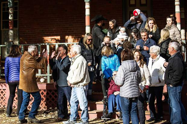 Three generations of Stapletons celebrate after taking a family photo at the Aspen Historical Society building on Saturday morning.