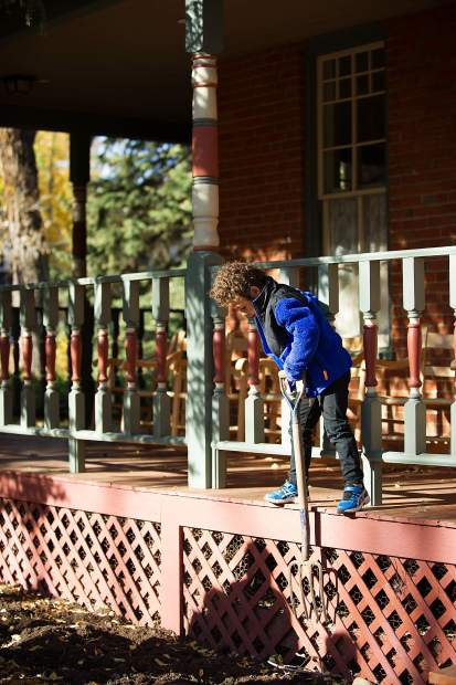 Dutch Stapleton, 6, plays with a pitchfork he found before the Stapleton family photo outside of the Aspen Historical Society on Saturday.