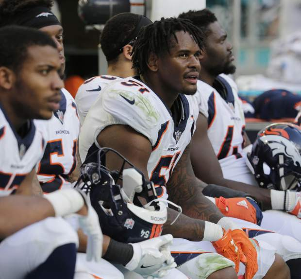 Denver Broncos inside linebacker Todd Davis (51), center, looks in frustration from the sidelines, during the second half of an NFL football game against the Miami Dolphins, Sunday, Dec. 3, 2017, in Miami Gardens, Fla. The Dolphins defeated the Broncos 35-9. (AP Photo/Lynne Sladky)
