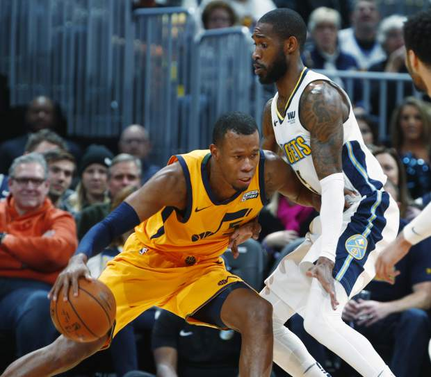 Utah Jazz guard Rodney Hood, left, works the ball inside as Denver Nuggets guard Will Barton defends in the first half of an NBA basketball game, Tuesday, Dec. 26, 2017, in Denver. (AP Photo/David Zalubowski)