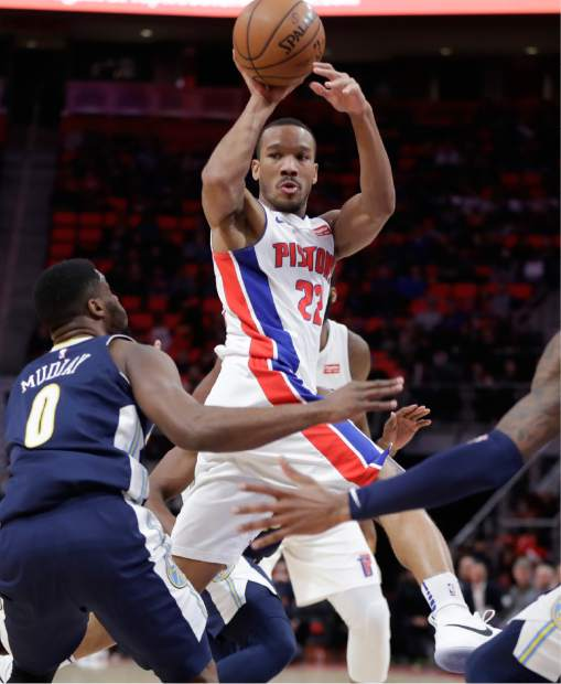 Detroit Pistons guard Avery Bradley passes during the first half of an NBA basketball game against the Denver Nuggets, Tuesday, Dec. 12, 2017, in Detroit. (AP Photo/Carlos Osorio)