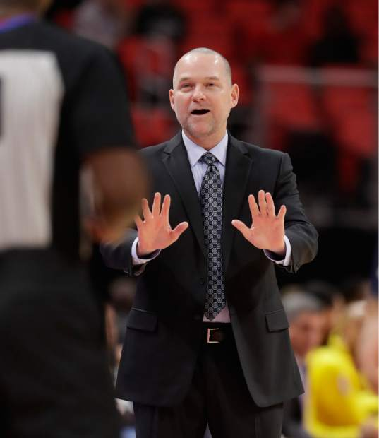 Denver Nuggets head coach Michael Malone disputes a call with referee James Williams during the first half of an NBA basketball game against the Detroit Pistons, Tuesday, Dec. 12, 2017, in Detroit. (AP Photo/Carlos Osorio)