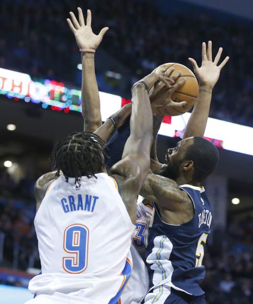 Denver Nuggets guard Will Barton (5) is fouled by Oklahoma City Thunder forward Jerami Grant (9) as he shoots in the second quarter of an NBA basketball game in Oklahoma City, Monday, Dec. 18, 2017. (AP Photo/Sue Ogrocki)
