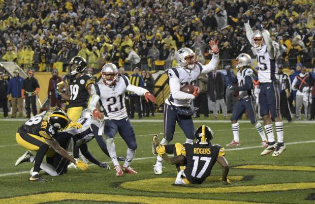 New England Patriots strong safety Duron Harmon, center, celebrates his interception in the end zone of a pass from Pittsburgh Steelers quarterback Ben Roethlisberger (7) during the second half of an NFL football game in Pittsburgh, Sunday, Dec. 17, 2017. The Patriots won 27-24. (AP Photo/Don Wright)