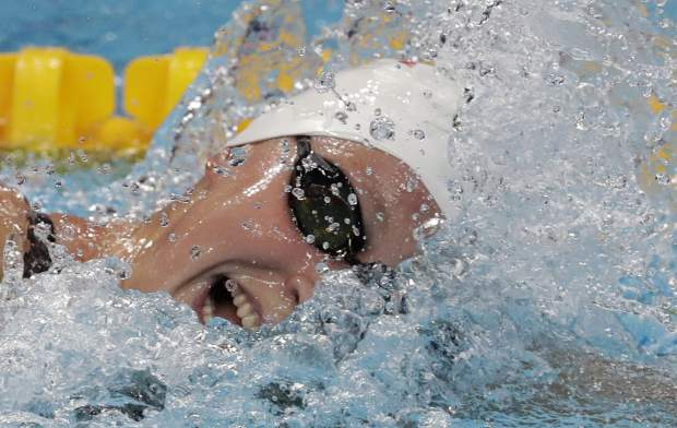 FILE - In this July 28, 2017, file photo, United States' Katie Ledecky competes in a women's 800-meter freestyle heat during the swimming competitions of the World Aquatics Championships, in Budapest, Hungary. Ledecky was named The Associated Press Female Athlete of the Year on Tuesday, Dec. 26, 2017. (AP Photo/Michael Sohn, File)