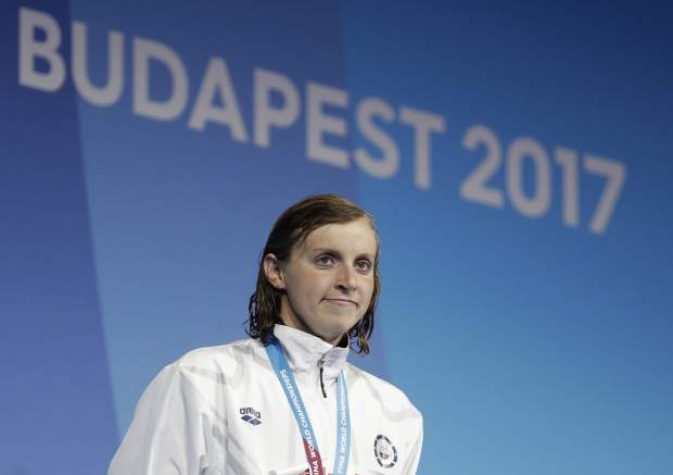 FILE - In this July 23, 2017, file photo, United States' gold medal winner Katie Ledecky smiles during the ceremony for the women's 400-meter final during the swimming competitions of the World Aquatics Championships in Budapest, Hungary. Ledecky was named The Associated Press Female Athlete of the Year on Tuesday, Dec. 26, 2017. (AP Photo/Michael Sohn, File)