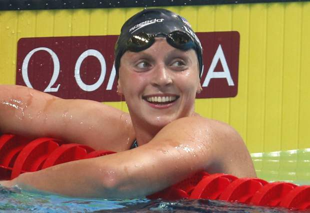 FILE - In this July 25, 2017, file photo, United States' Katie Ledecky reacts after winning the gold medal in the women's 1500-meter freestyle final during the swimming competitions of the World Aquatics Championships in Budapest, Hungary. Ledecky was named The Associated Press Female Athlete of the Year on Tuesday, Dec. 26, 2017. (AP Photo/Darko Bandic, File)