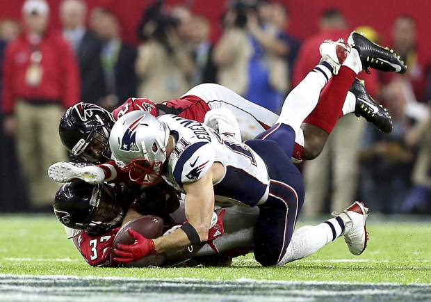 FILE - In this Feb. 5, 2017, file photo, New England Patriots Julian Edelman (11) makes a catch against the Atlanta Falcons during NFL football's Super Bowl 51 in Houston. (AP Photo/Doug Benc)