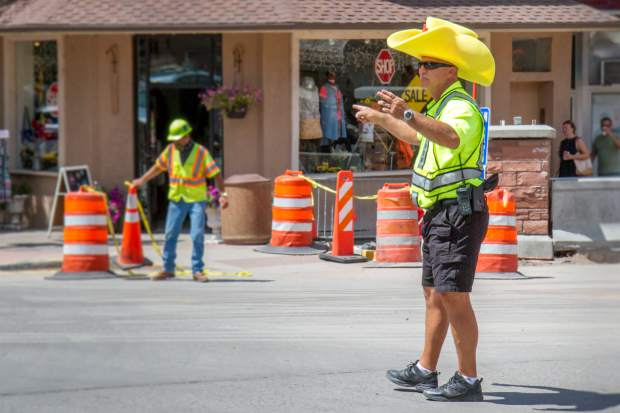 Glenwood Springs Police Chief Terry Wilson directs traffic in style during week one of the Grand Avenue Bridge Detour on Aug. 16.