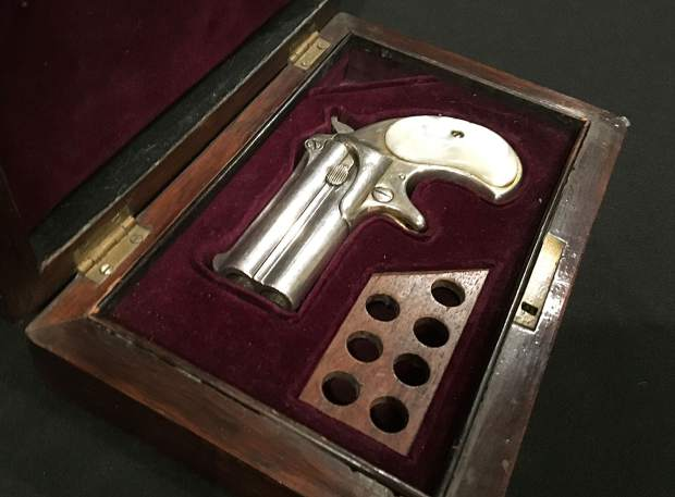 This 1866 Remington derringer is said to be one of the few possessions found in Doc Holliday's room at the Hotel Glenwood after he died. Or it could be a fake.