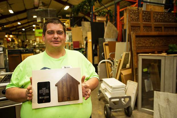 Habitat for Humanity employee Brian Wilson reports for duty at the downvalley ReStore on Wednesday. Wilson received a plaque acknowledging him as