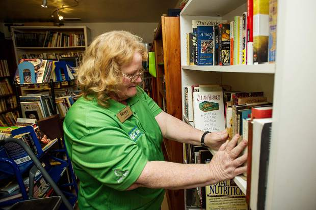 Habitat for Humanity Roaring Fork employee Charlene Romero arranges book donations at the ReStore on Wednesday.