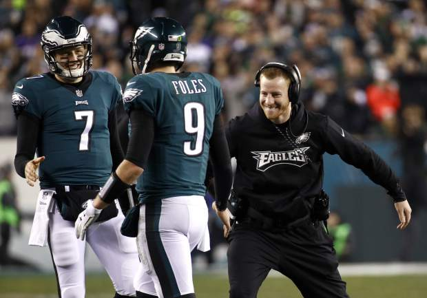 Philadelphia Eagles' Carson Wentz congratulates Nick Foles (9) during the second half of the NFL football NFC championship game against the Minnesota Vikings Sunday, Jan. 21, 2018, in Philadelphia. (AP Photo/Patrick Semansky)