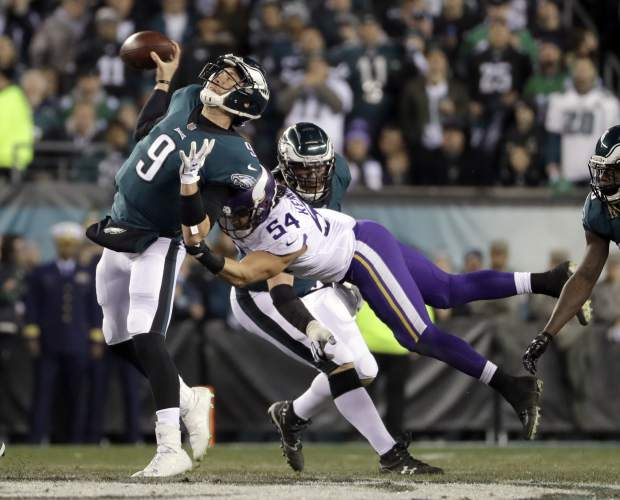 Philadelphia Eagles quarterback Nick Foles throws as he's hit by Minnesota Vikings' Eric Kendricks during the first half of the NFL football NFC championship game Sunday, Jan. 21, 2018, in Philadelphia. (AP Photo/Matt Slocum)