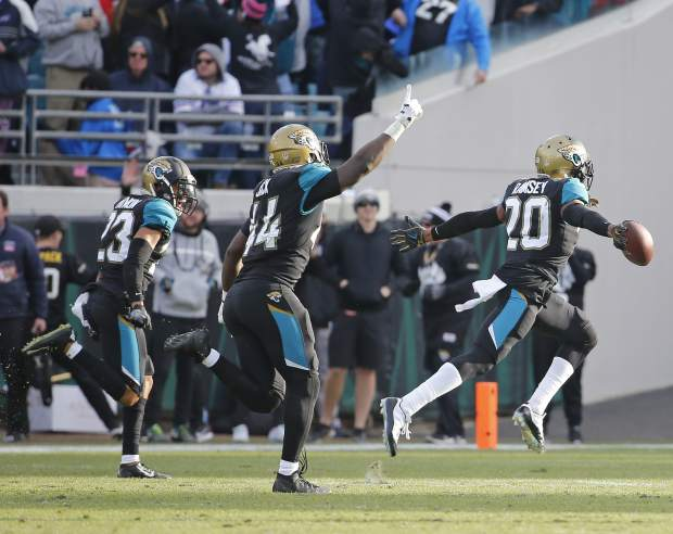 Jacksonville Jaguars cornerback Jalen Ramsey (20) celebrates with a teammate after intercepting a pass against the Buffalo Bills in the final seconds an NFL wild-card playoff football game, Sunday, Jan. 7, 2018, in Jacksonville, Fla. (AP Photo/Stephen B. Morton)