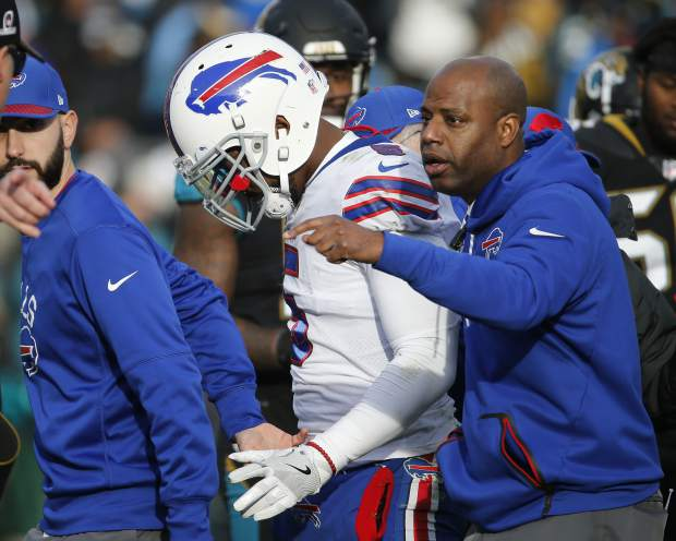 Buffalo Bills quarterback Tyrod Taylor leaves the field after he was injured in the second half of an NFL wild-card playoff football game against the Jacksonville Jaguars, Sunday, Jan. 7, 2018, in Jacksonville, Fla. (AP Photo/Stephen B. Morton)