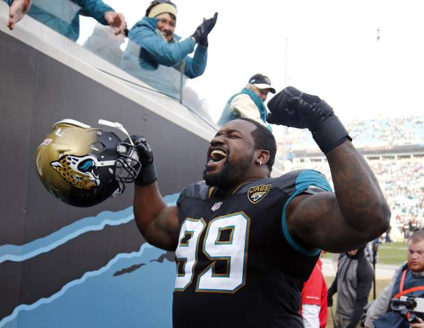 Jacksonville Jaguars defensive tackle Marcell Dareus (99) flexes as he celebrates after defeating the Buffalo Bills in an NFL wild-card playoff football game, Sunday, Jan. 7, 2018, in Jacksonville, Fla. (AP Photo/Stephen B. Morton)