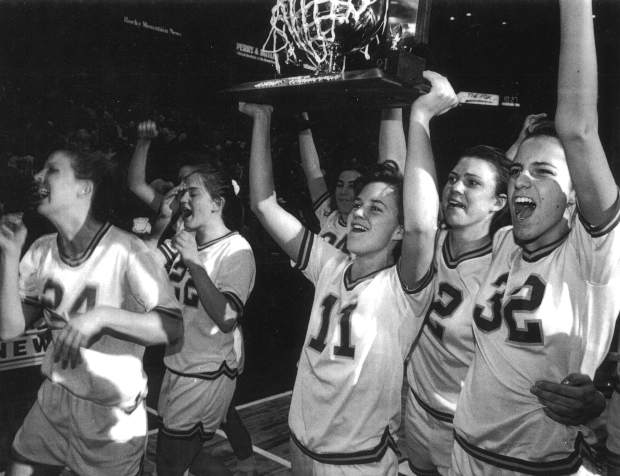 Tricia Bader, No. 11, hoists one of the three Colorado girls basketball championships she helped her Rams win from 1989-91.