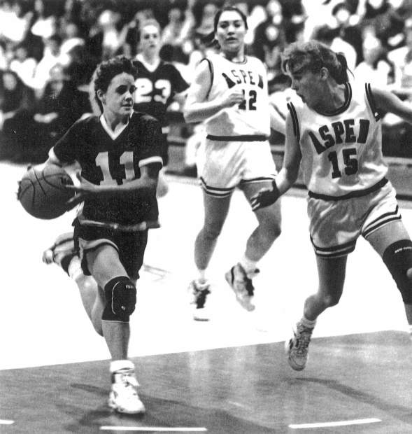Tricia Bader dribbles past some Aspen defenders during her high school playing years.