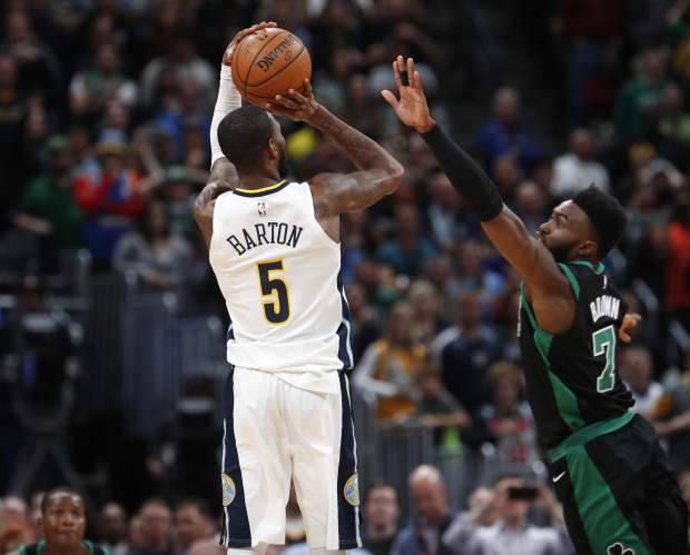 Denver Nuggets guard Will Barton, left, puts up a shot as time expires over Boston Celtics guard Jaylen Brown in the second half of an NBA basketball game Monday, Jan. 29, 2018, in Denver. The Celtics won 111-110. (AP Photo/David Zalubowski)
