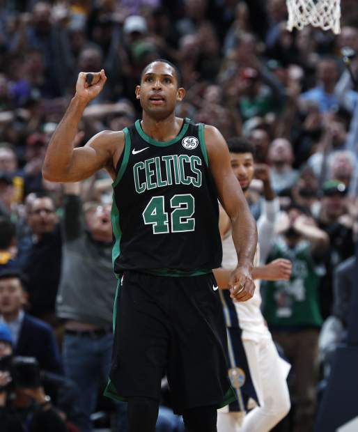 Boston Celtics forward Al Horford celebrates as time expires against the Denver Nuggets in the second half of an NBA basketball game Monday, Jan. 29, 2018, in Denver. The Celtics won 111-110. (AP Photo/David Zalubowski)