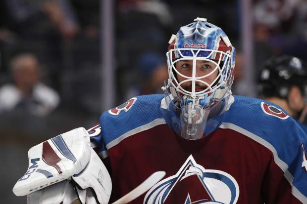 Colorado Avalanche goaltender Jonathan Bernier waits for play to resume against the against Anaheim Ducks in the second period of an NHL hockey game Monday, Jan. 15, 2018, in Denver. (AP Photo/David Zalubowski)