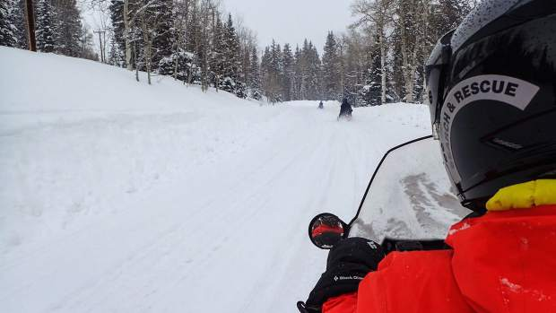 Garfield County Search and Rescue members take to snowmobiles to head into the back country.