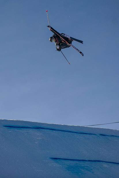 Gus Kenworthy spins off the second jump on his first run for the men's ski slopestyle finals in Snowmass on Sunday. Kenworthy won from his second run score of 95.40.