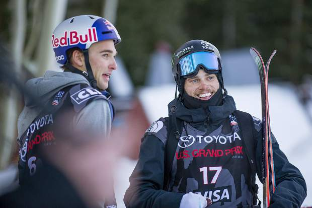 American skier Gus Kenworthy, right, laughs with Nick Goepper after completing their third runs for the men's ski slopestyle finals in Snowmass on Sunday. Kenworthy won from his second run score of 95.40 also securing an Olympic spot and Goepper took second.