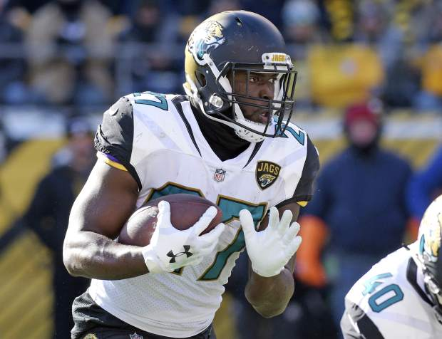 Jacksonville Jaguars running back Leonard Fournette (27) carries the ball during the first half of an NFL divisional football AFC playoff game against the Pittsburgh Steelers in Pittsburgh, Sunday, Jan. 14, 2018. (AP Photo/Don Wright)