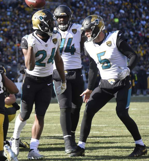 Jacksonville Jaguars running back T.J. Yeldon (24) celebrate his touchdown with quarterback Blake Bortles (5) during the first half of an NFL divisional football AFC playoff against the Pittsburgh Steelers game in Pittsburgh, Sunday, Jan. 14, 2018. (AP Photo/Don Wright)