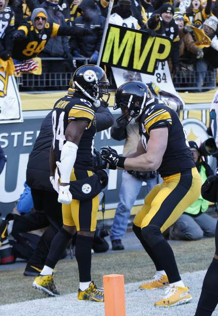 Pittsburgh Steelers wide receiver Antonio Brown (84) celebrates his touchdown with Vance McDonald during the first half of an NFL divisional football AFC playoff game against the Jacksonville Jaguars in Pittsburgh, Sunday, Jan. 14, 2018. (AP Photo/Keith Srakocic)