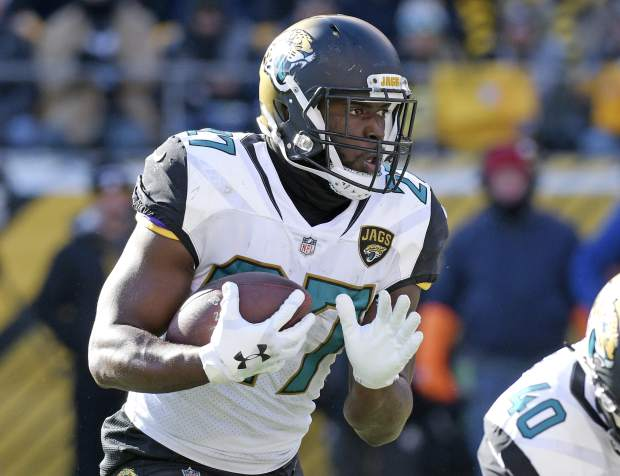 Jacksonville Jaguars running back Leonard Fournette (27) carries the ball during the first half of an NFL divisional football AFC playoff game in Pittsburgh, Sunday, Jan. 14, 2018. (AP Photo/Don Wright)