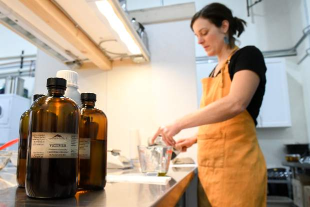 Soap maker Pola Oginski mixes together the ingredients to make the Vetiver Grey soap at the Osmia Organics facility.