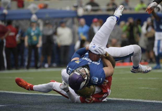 NFC wide receiver Adam Thielen (19), of the Minnesota Vikings, scores a touchdown as AFC defensive back A.J. Buoy (21), of the Jacksonville Jaguars defends, during the first half of the NFL Pro Bowl football game, Sunday, Jan. 28, 2018, in Orlando, Fla. (AP Photo/Phelan M Ebenhack)