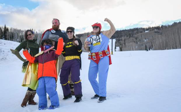 Contestants in the Skier Appreciation Day super hero and super villian costume contest pose for a group photo outside of the lodge at Sunlight Mountain Resort on Friday. The day included $20 lift tickets with proceeds benefitting United Way, free yoga, live music and prize give aways. Jordan Testerman as