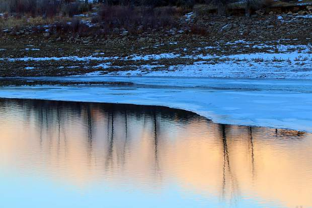 Rifle Gap Reservoir is found partially frozen after a recent cold snap.