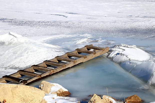 Ice pushes its way up the shore at Rifle Gap Reservoir after a resent cold snap followed by warmer temperatures.
