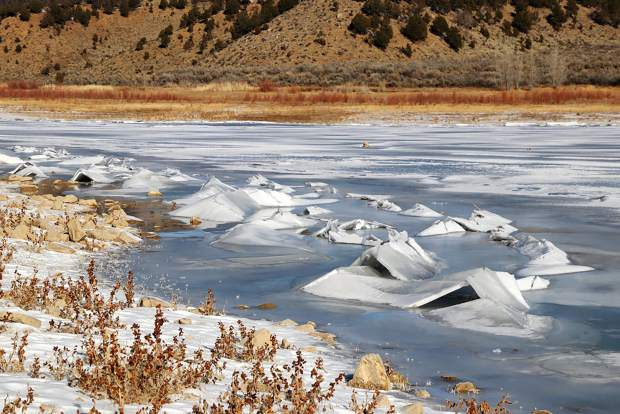 Ice pushes its way up the shore at Rifle Gap Reservoir after a recent cold snap followed by warmer temperatures.